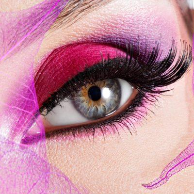Closeup female eye with  beautiful fashion bright pink makeup